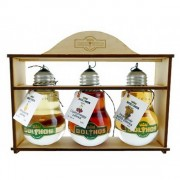 3 different flavor palinka in wood box  with dried fruit by Bolyhos